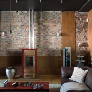 Alphen Constantia Townhouse complete redesign by Jenny Mills Architects - Living Area with a fireplace