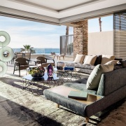 Connected Atlantic Living - Indoor Living with Roche Bobois furniture and views out to the Atlantic Seaboard