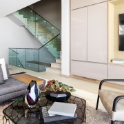 Connected Atlantic Living - Stair and Living Area with Roche Bobois Furniture
