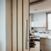 Kitchen entry door detail in Bantry Bay designed by JMA