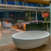 Contemporary Beach House Bathroom Open to Bedroom