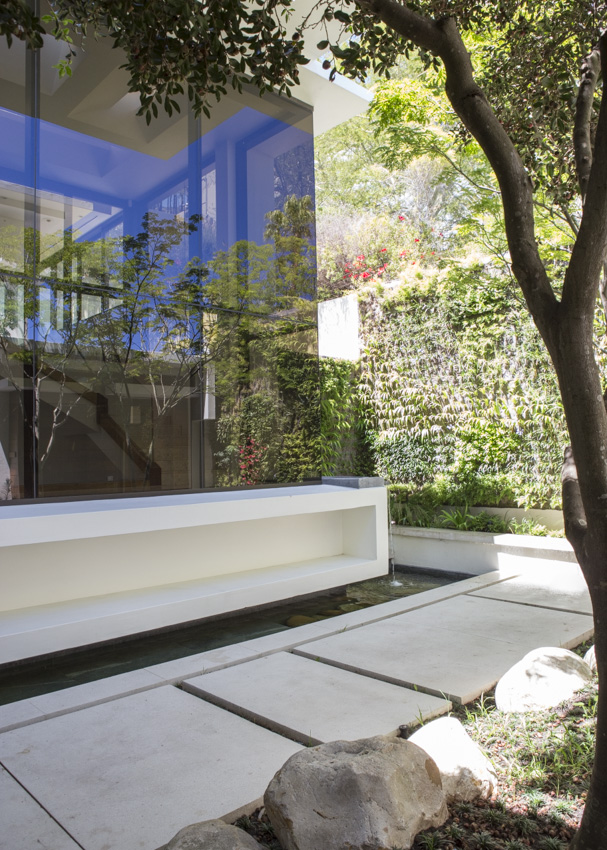 Avenue Fresnaye Villa. Light filled view of the courtyard with large windows in the architectural design that allow natural light and views of the garden trees to penetrate.
